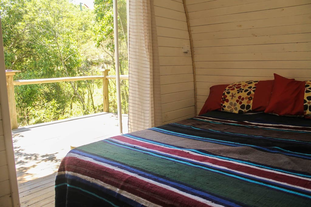 Bed and private deck.