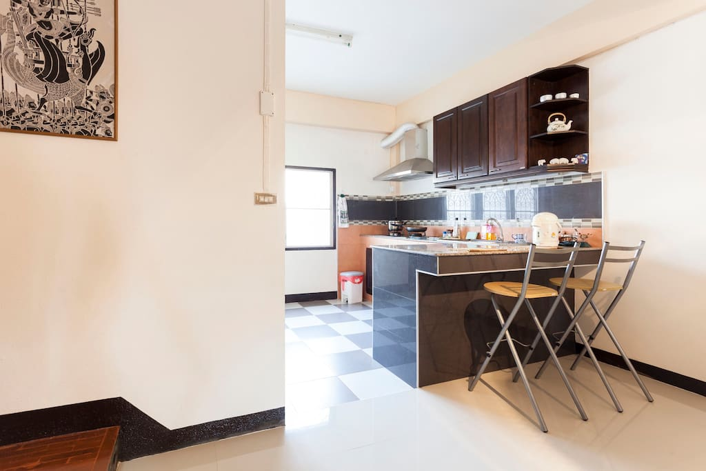 The L shaped granite counter top also serves as a small bar for a quick breakfast or lunch.