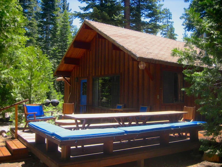 MAIN cabin with spacious deck and picnic tables to seat up to 24 people
