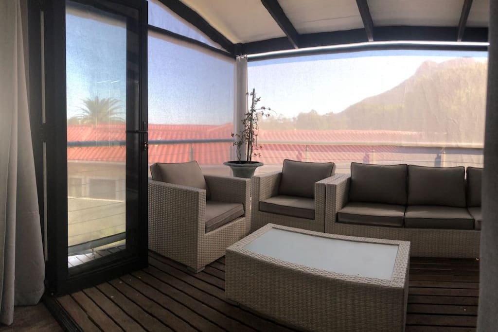Sun-downers in the cool while having views of the mountains to the right and the salt lake to the left
