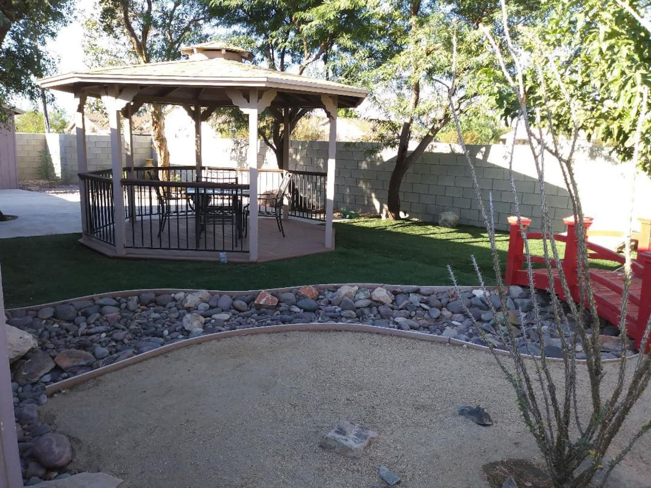 Landscaped backyard with gazebo.  Enjoy the mountain view by day and star filled skies by night.