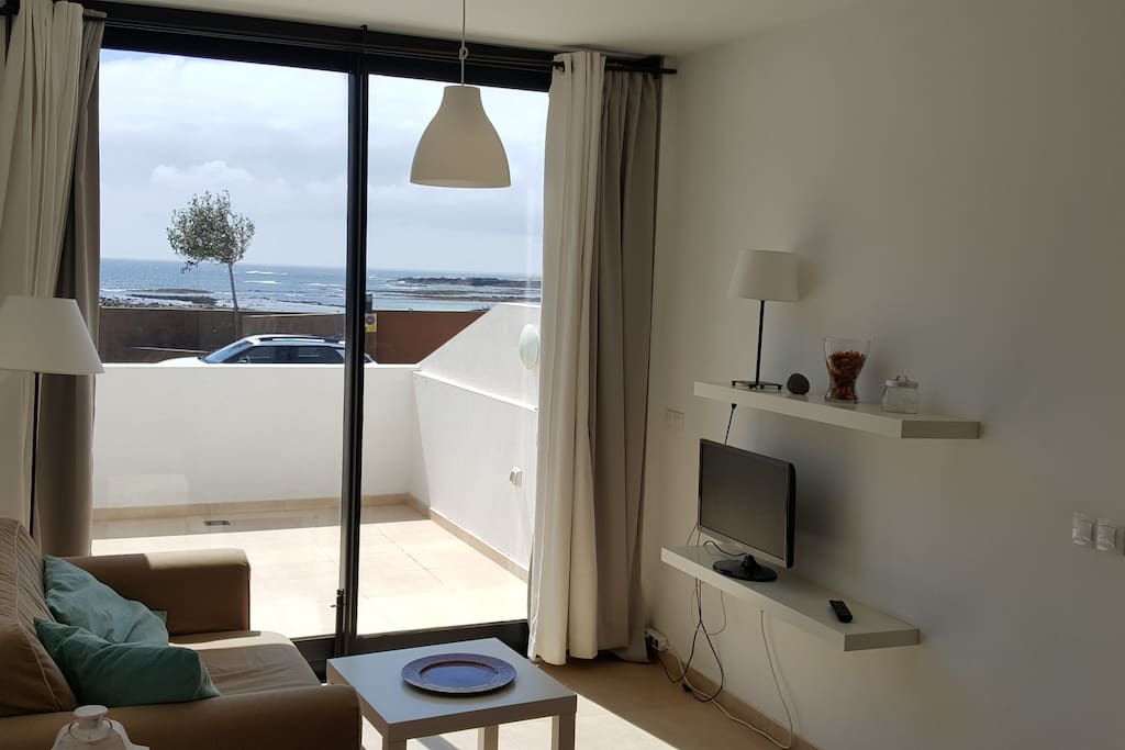 SOFA AND TV WITH SEAVIEW