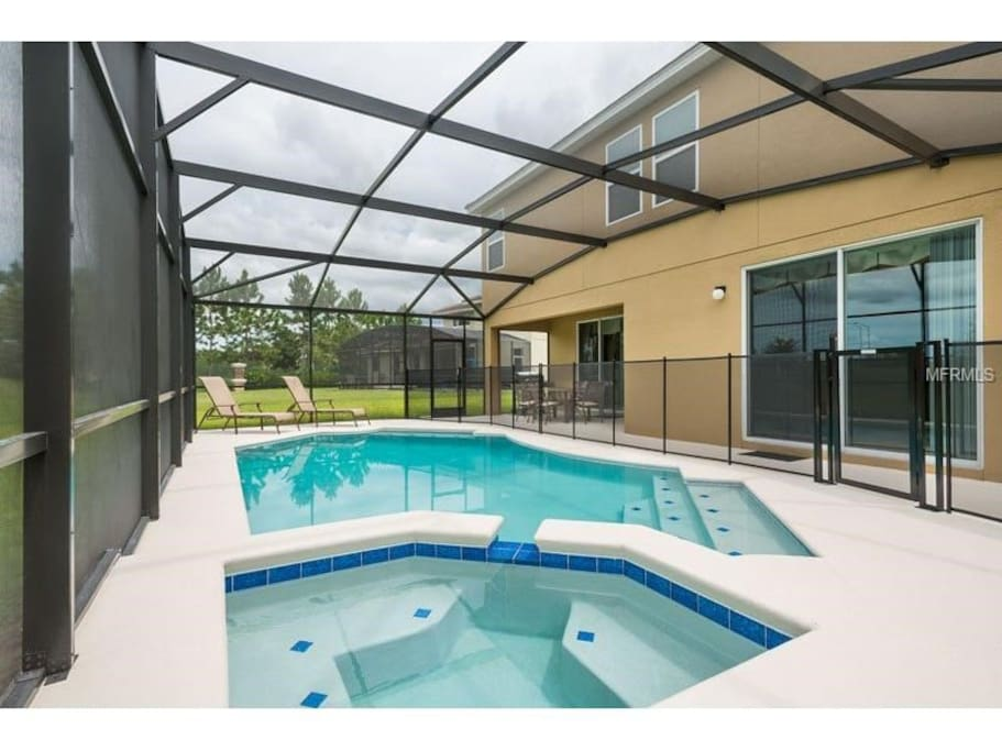 Heated Pool and spillover Hot tub ( Note:  safety fence has been removed)