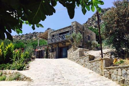 Contemporary Stone House / Turkbuku - Milas
