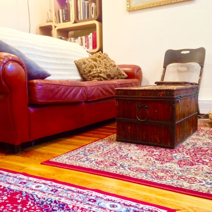 Living room couch and coffee table. You will use this area to sleep either on an air mattress or the couch.