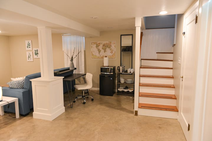"""Main landing of the """"studio"""" portion of the unit; stairwell leading to the entrance."""