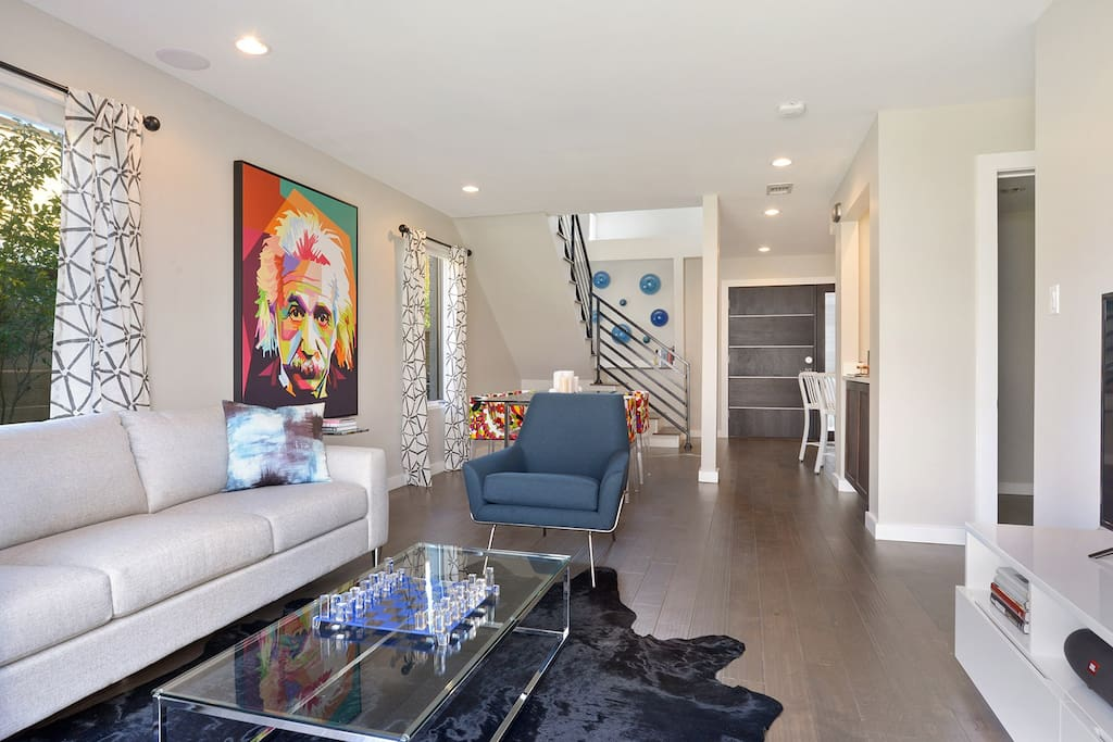 Relax in this modern space embraced with vintage New Orleans charm!  The spacious main level offers comfort and style.  Features include luxurious living and dining rooms, kitchen, and powder room.