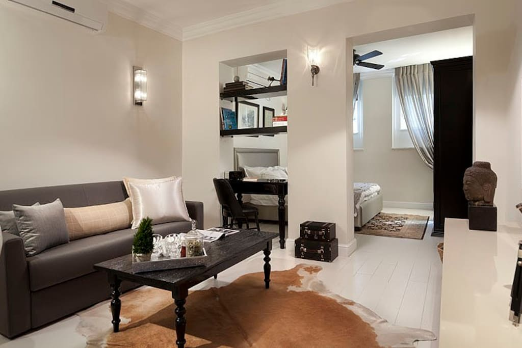 Our living room is luxurious but comfortable, the sofa can easily turn into a double bed.