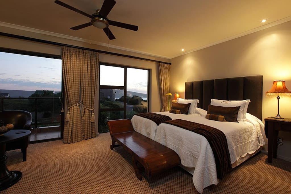 Luxury Island room with option of twin bed or king size bed.  Floor to ceiling windows offer a fantastic view of the lagoon