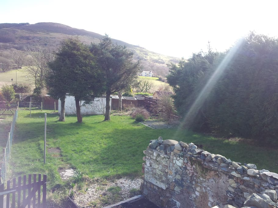 There are beautiful views from the front and the back of the house of the mountains and also over towards Anglesey.