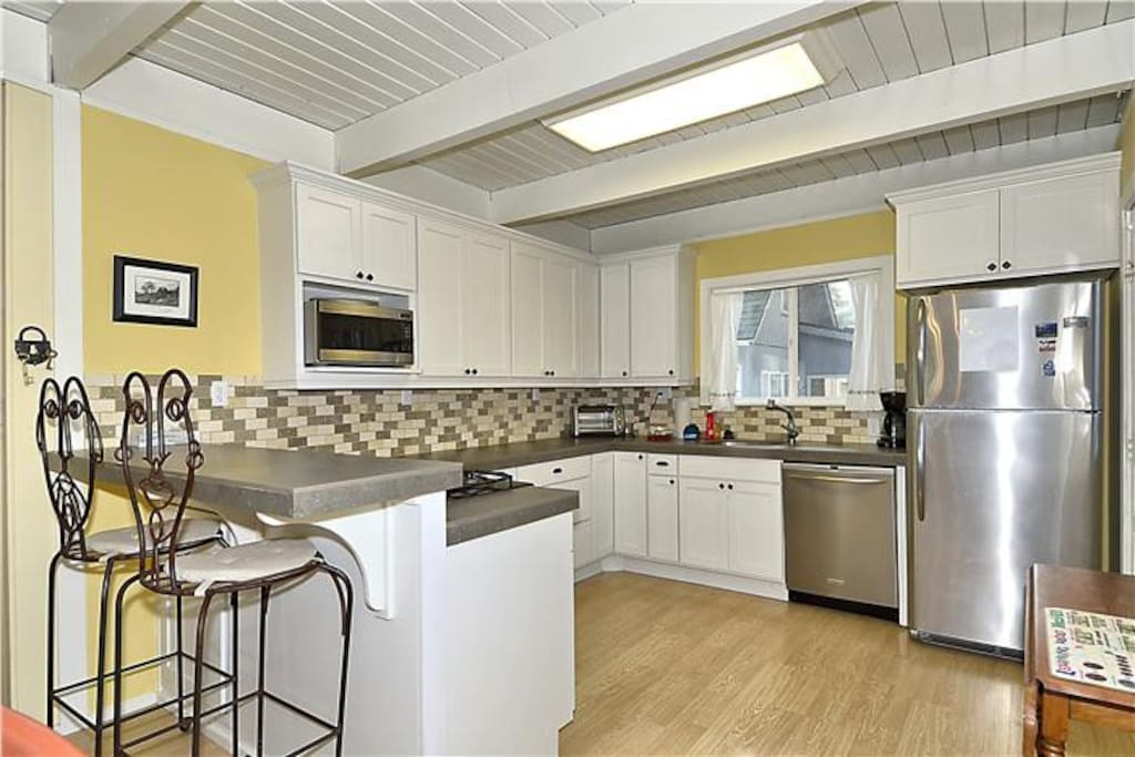 Fully equipped kitchen with extras: slow cooker, french press, griddle, blender, mixer.