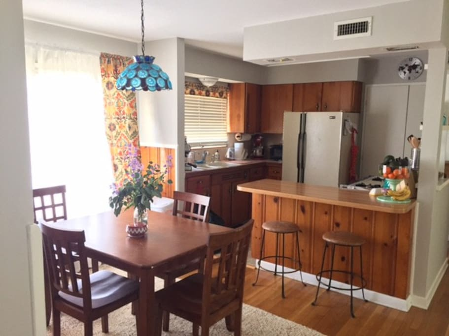 Full kitchen with barstools and dining area