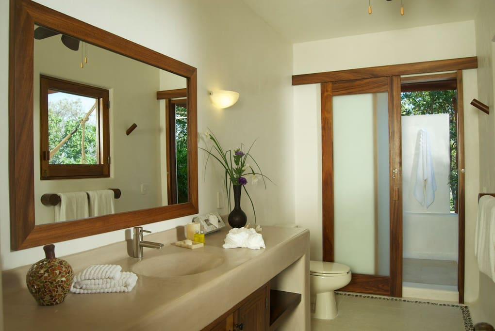 The spacious suite bathrooms lead to an outdoor shower