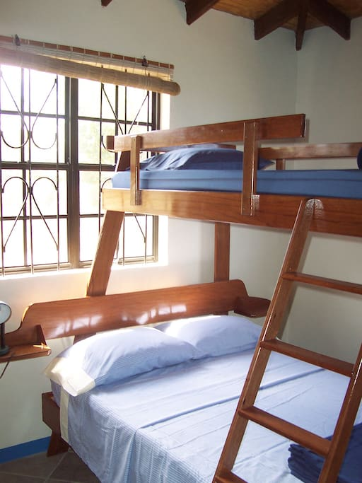 Double bed and single bunk in second bedroom