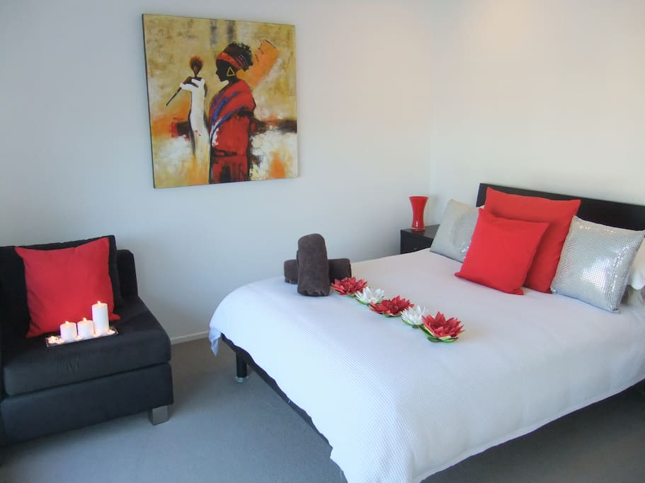 The Double Bedroom overlooks the pool and entertaining area also the water at B and B on the Bay your Gold Coast Accommodation