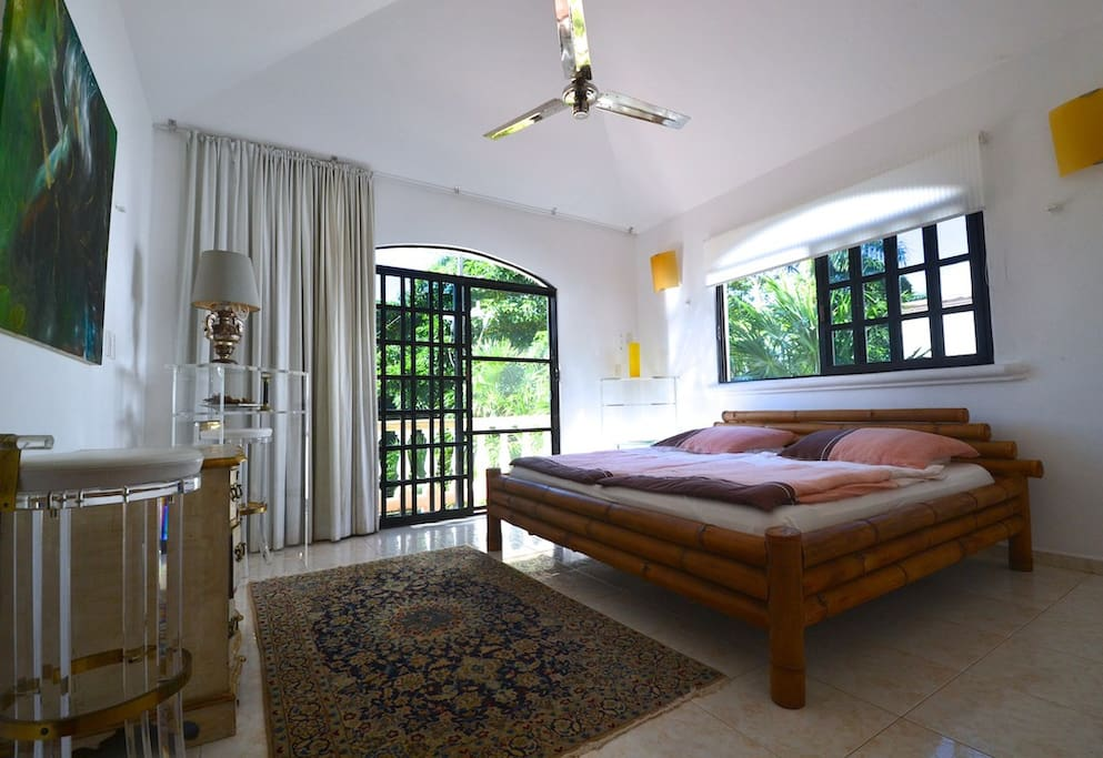 King size bed and the window to the balcony