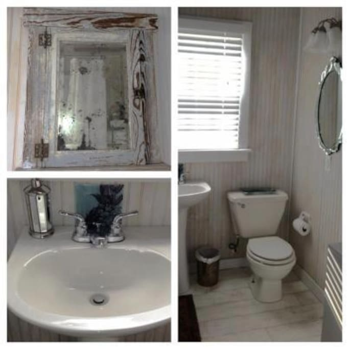 Bathroom features a pedestal sink and claw foot tub/shower. Bath towels are provided.