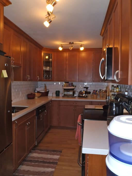 "Warm, Welcoming and Spacious Kitchen for your delicious home cooked meals or ""quick fix"" travel meals on the go ;)"