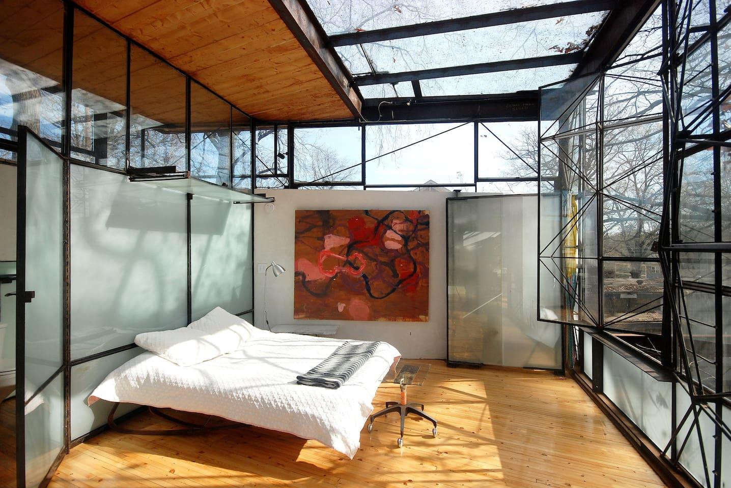 upstairs bedroom and mini closet- bathroom behind glass wall