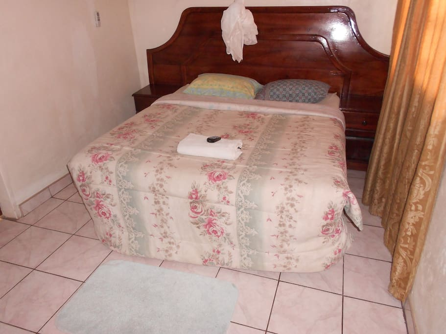 Double Bed Room which has one Double Bed.