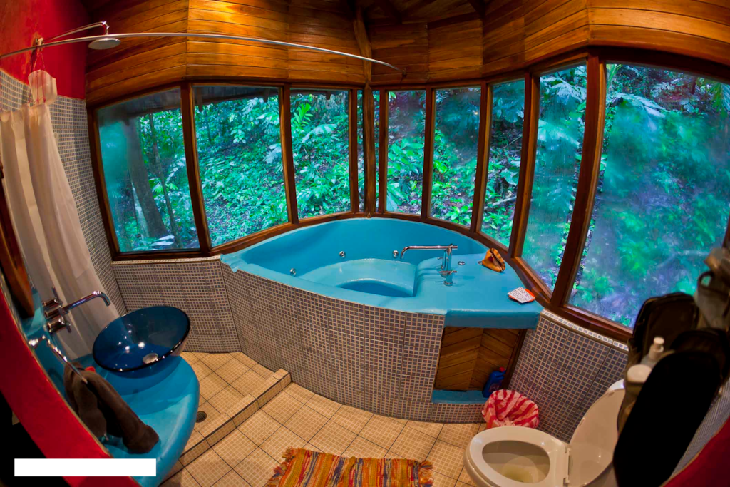bathroom with private hot tub ( be aware this house has this tub but without the jets )