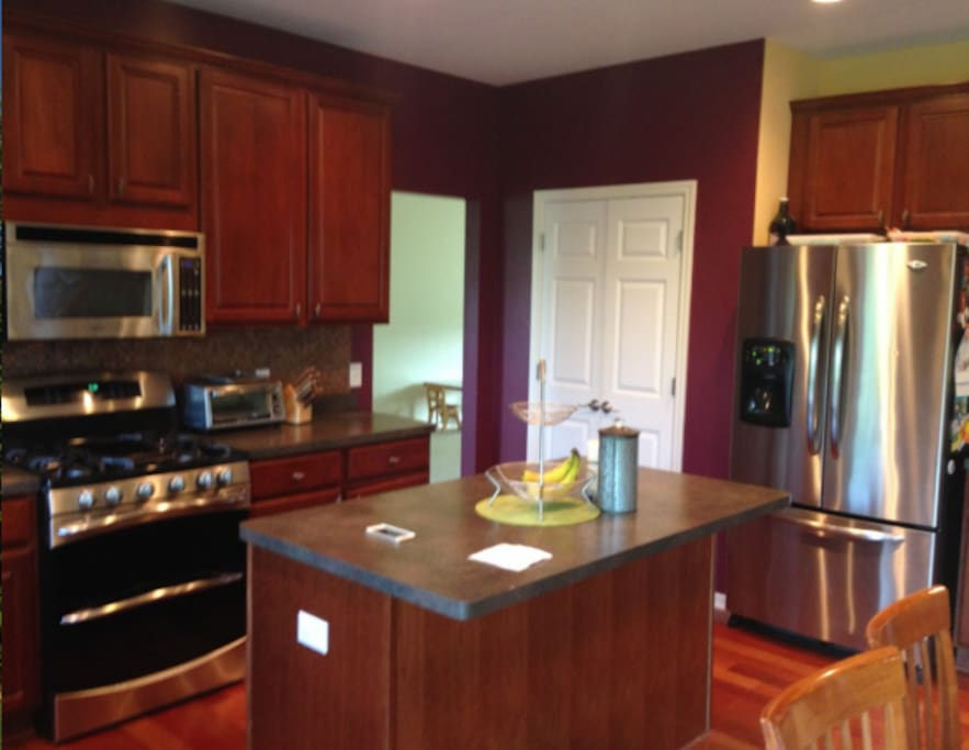Large kitchen with center island and modern appliances
