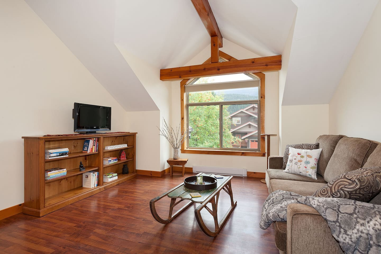 Large open living area with gorgeous views of Mt. Currie, cable TV.