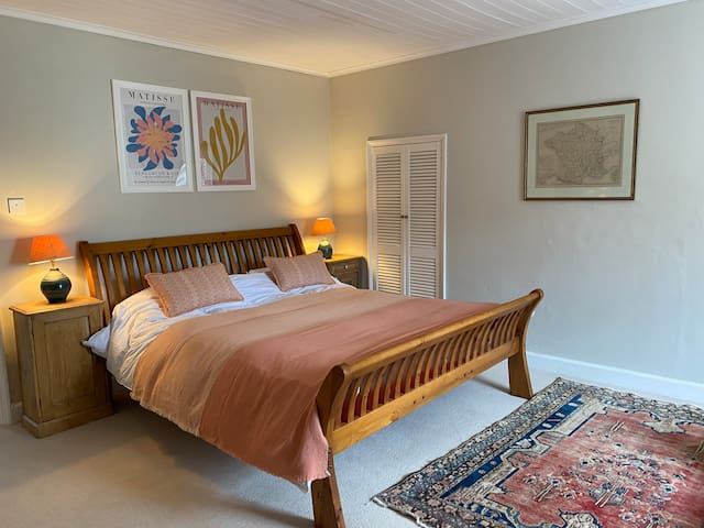 Master bedroom with super king size bed and washbasin