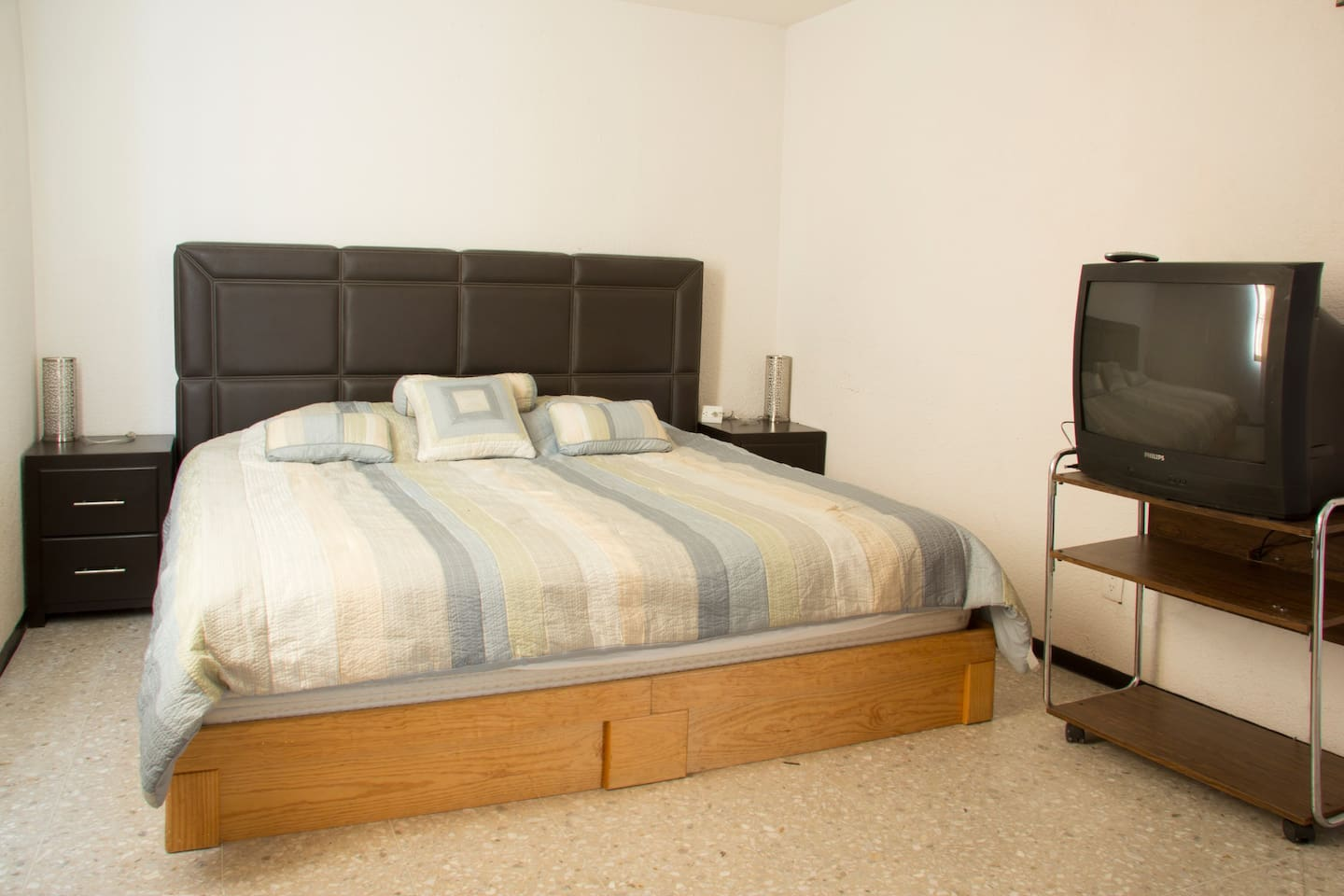 King size bedroom with TV