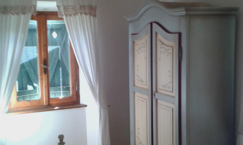 Hand painted wardrobes provide good storage in the  bedrooms.