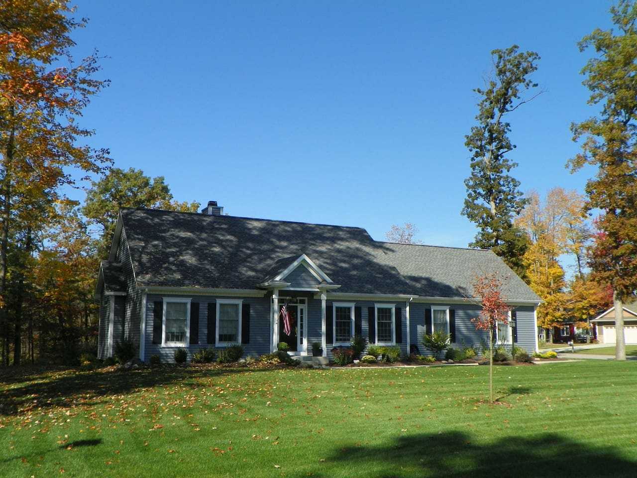 New England colonial cape style ranch with full daylight basement.