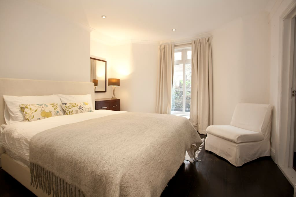 Fabulous king size bed with an amazingly comfortable mattress  - plush and pampering white cotton bedding to match