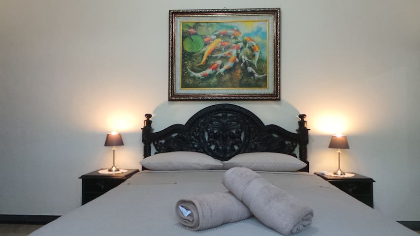 Medewi Manor: Surfers Heaven, Poolside apartment. Bedroom...