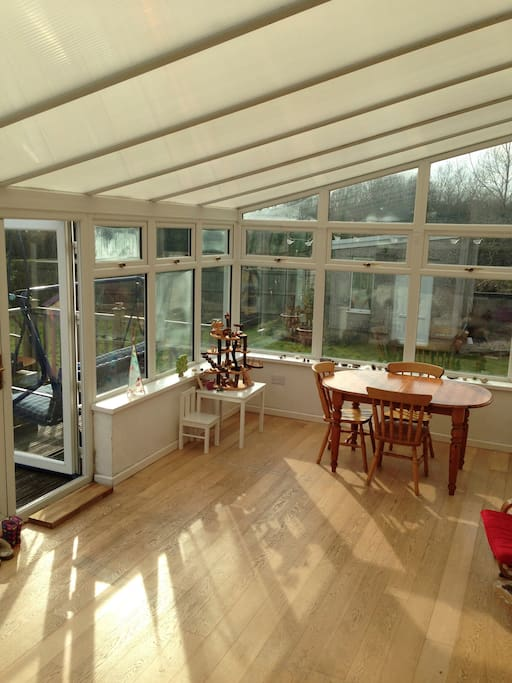 Conservatory opening out onto south facing decking and garden