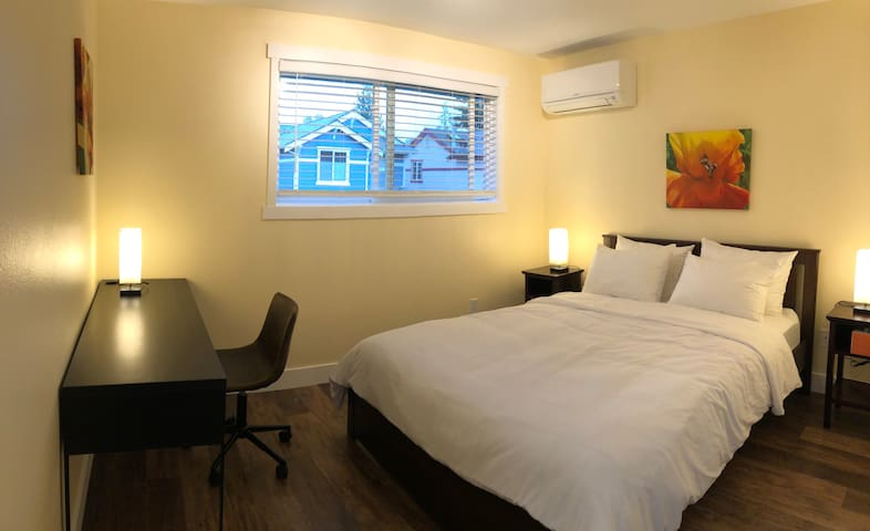 The second bedroom also features a queen bed, as well as a writing desk