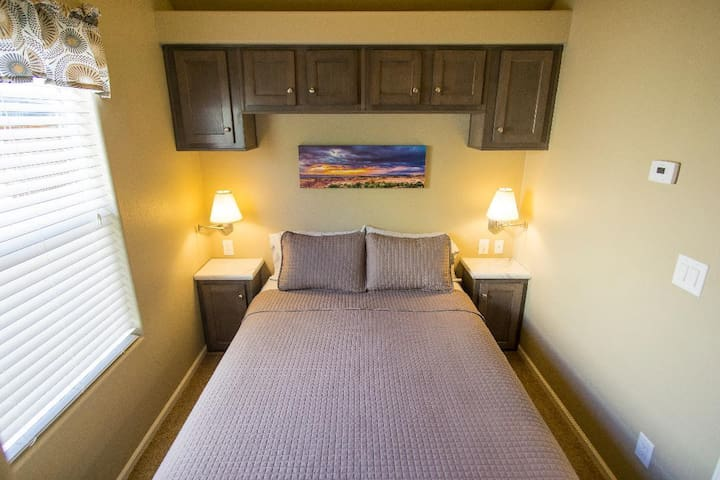 Master room with queen bed. There is a large closet and drawer space available in this room.