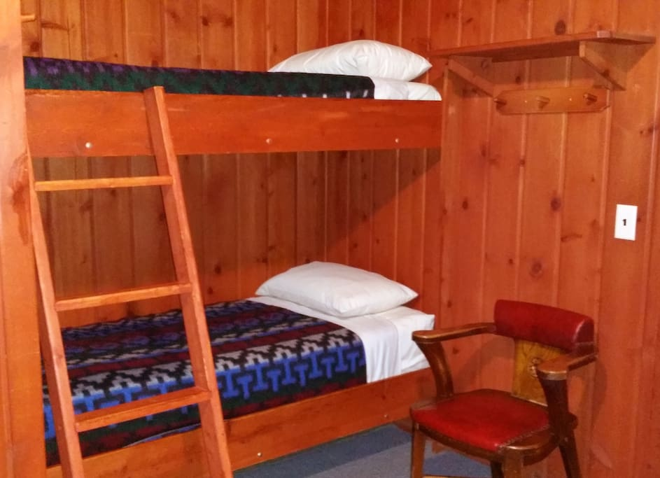 Most bunk rooms have 6 twin size bunks. Please note that there may be some variation as we have several rooms with this layout and may have changed decor and linens since photo taken.