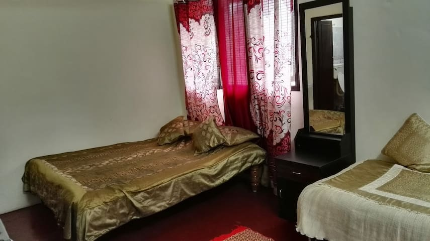 Celebrations Home Stay - Family Double Bedroom