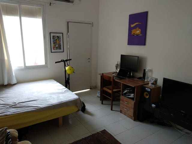 Room 1 bed and desk