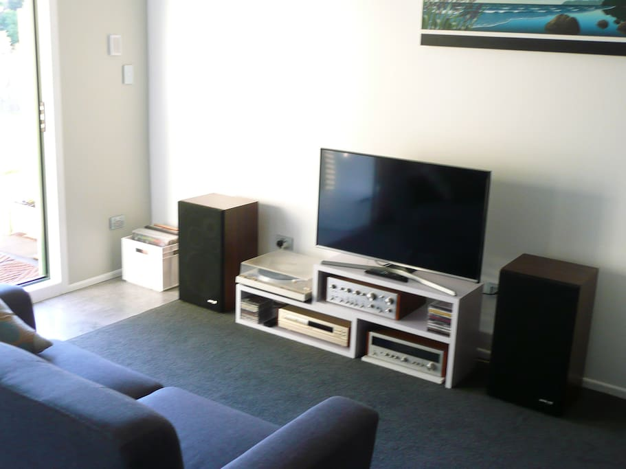 The entertainment area consists of a new Samsung TV which takes USB and HDMI plug ins. There is a retro stereo with vinyls and cds for the music lover.
