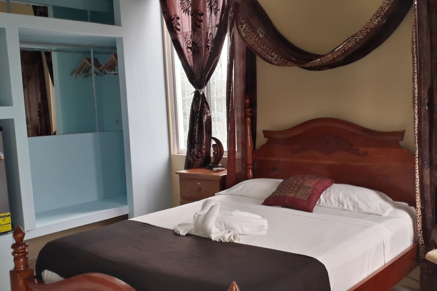 Elegant and spacious bedroom overlooking the breathtaking Caribbean Sea! Comes with Mahogany elegant queen bed, air conditioner, fans, windows and door for maximum comfort and satisfaction.