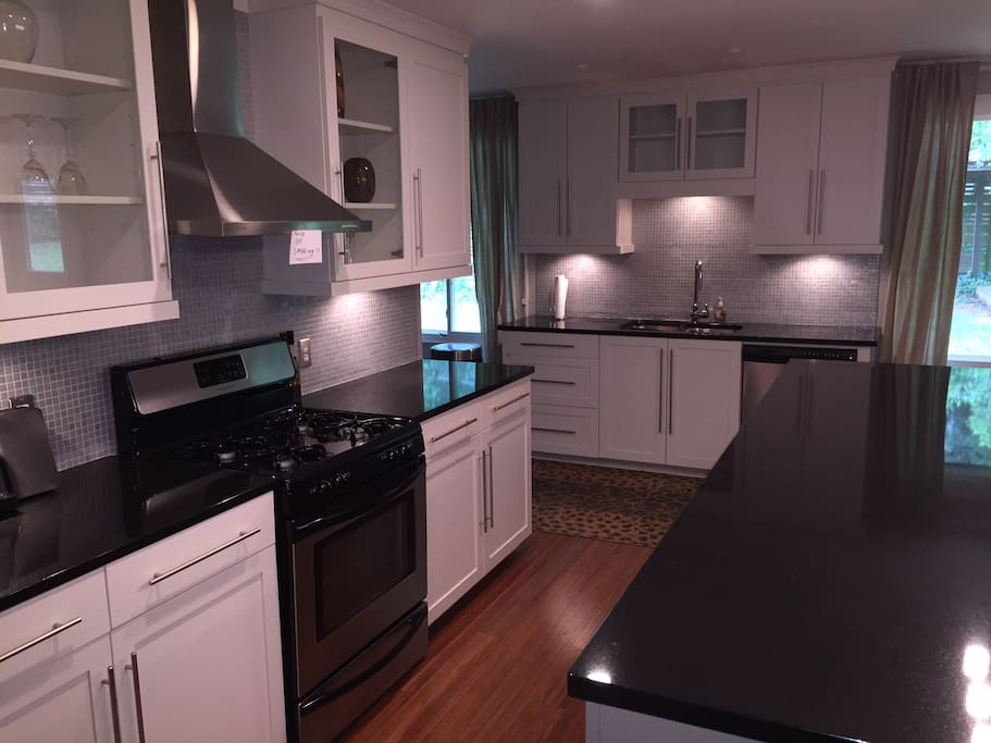 great open kitchen for entertaining - fully equipped just like home (pots, pans, coffee maker, blender, microwave ..........