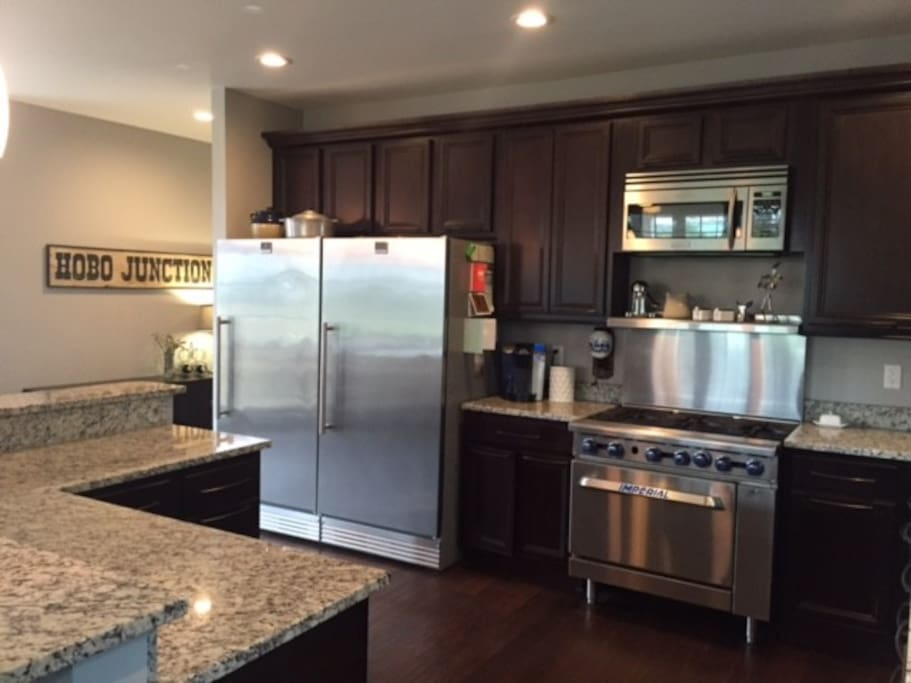 Beautiful Chef's Kitchen complete with commercial appliances (including the outdoor grill).  Lots of counter space for putting together a killer family meal.