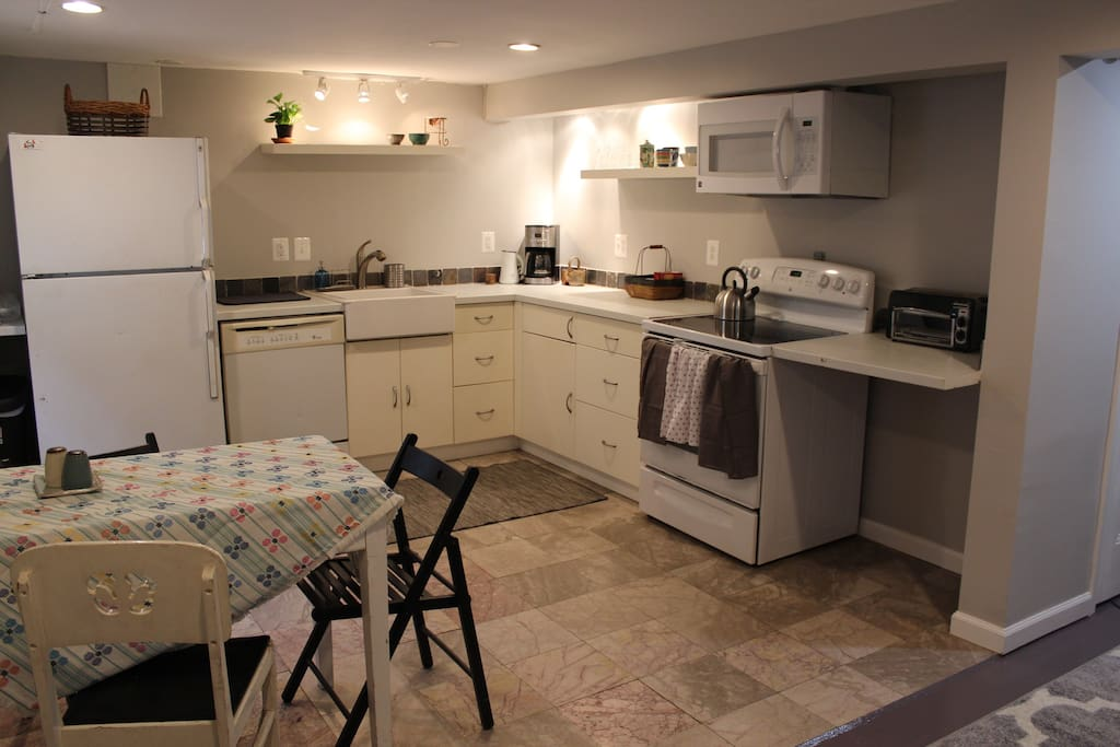 Large kitchen w/ full sized stove, coffeepot, toaster, microwave