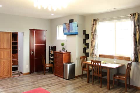 Living space features a flat screen TV (with local channels and connections for your phone or laptop); Dining table and a spacious closet