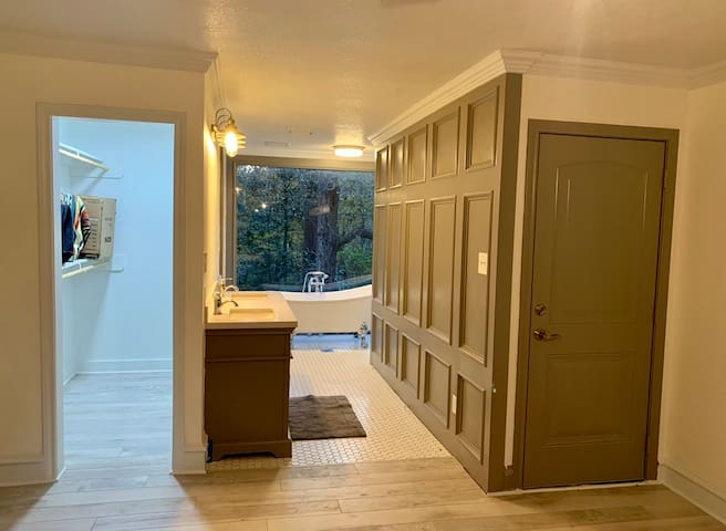 Master bedroom suite with custom bathroom that has a bear claw tub and a 4X5 walk in shower.