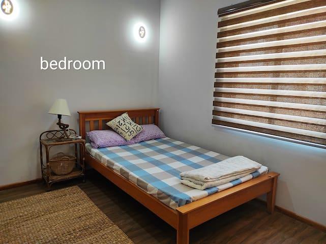 Single bedroom with attach bathroom .