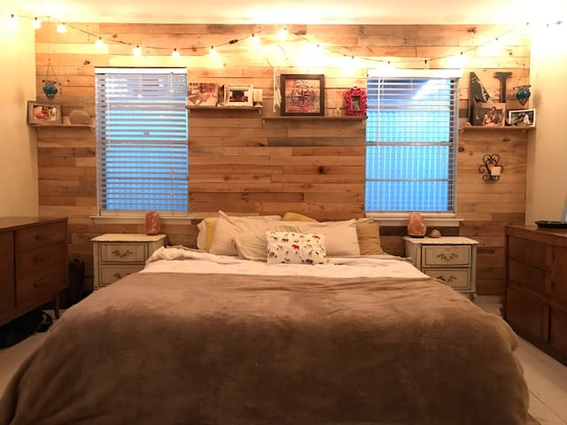 Cozy master bedroom with king size bed and Anthropology feel.