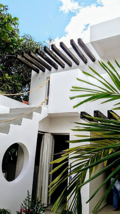 Casa Isla in Tulum is peaceful and beautiful space on the heart of Tulum town with great out door spaces to chill out.