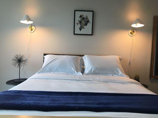 Tempurpedic bed, high quality linens, modern aesthetics